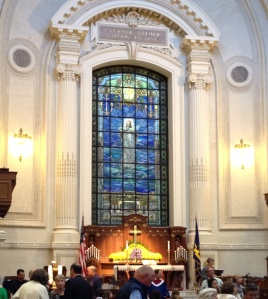Beautiful sanctuary. The words over the stained glass window are the opening line to the Navy Hymn . . .