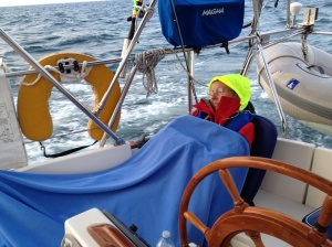 Ems napping in the cockpit. The bright yellow thing on my head is the glow in the dark hood from my foul weather jacket.