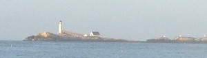 The lighthouse as we leave the Isle of Shoals in the sun.