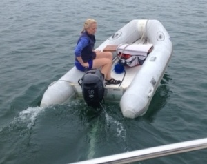 Ems practicing her dinghy driving.