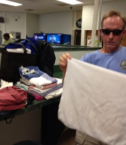 "Here you have it folks - Frank folding laundry in the public laundromat in Greenport, NY. He left for a while saying he was going to the bank. 25 minutes later he returned - the bank was just around the corner. ""Going to the bank"" is evidently synonymous with ""going for a walk!"""