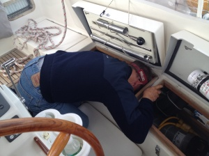 Frank has found that, while I'm at the helm and conditions are calm, he likes to do boat chores. There were OH so many things I could have done to him at this moment, but I resisted the urge . . .