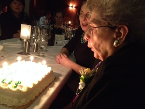 Mama blowing out her candles with sister Frances behind her.