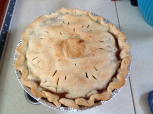 Apple pie decorated with a crust apple . . . with a worm coming out of it. Blame it on my sister Triana. i stole the idea from her!