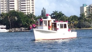 Red Christmas balls adorn this boat.