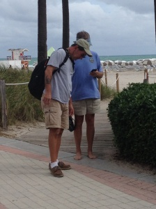 The guys conferring on the Chris Parker's latest weather forecast for passage to the Bahamas.