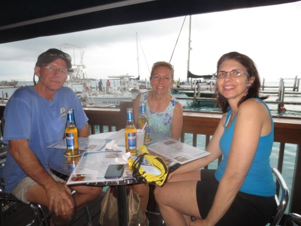 After walking to the BTC office to get cell phones and SIM cards for communications, the exhausted crew stops at Big John's for dinner. Anthony is behind the camera. We all toast to the fact that we made it to the Bahamas by boat.