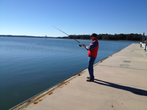 Thanksgiving morning was less windy and brilliantly sunny. After visiting with family by phone, Frank tried some fishing off the marina docks while I prepped some side dishes for our feast with Magnolia. We did not have fish for Thanksgiving.