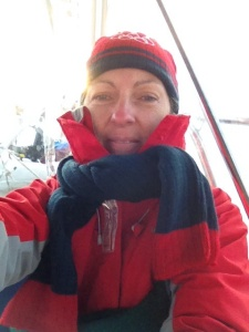 We wore all the layers of clothing that we had on the boat. When the sun is out, the enclosure warms the cockpit up nicely, but on cold, cloudy days, it is RAW! Jimmy Buffet does not write songs about this part.