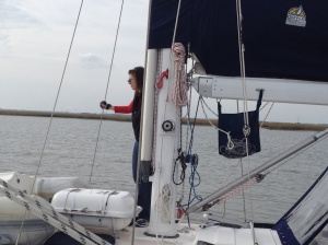 Annette looking over the preparations to go offshore. Dinghies are up and on the decks ready to go.