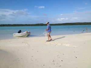 We took a short ride to a nearly deserted beach . . . there was really no one to be seen! We prepared to anchor the dinghy to the beach . . .