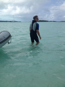 He's so cool looking in his wet suit! This is a guy who just looks like he grew up around the water.
