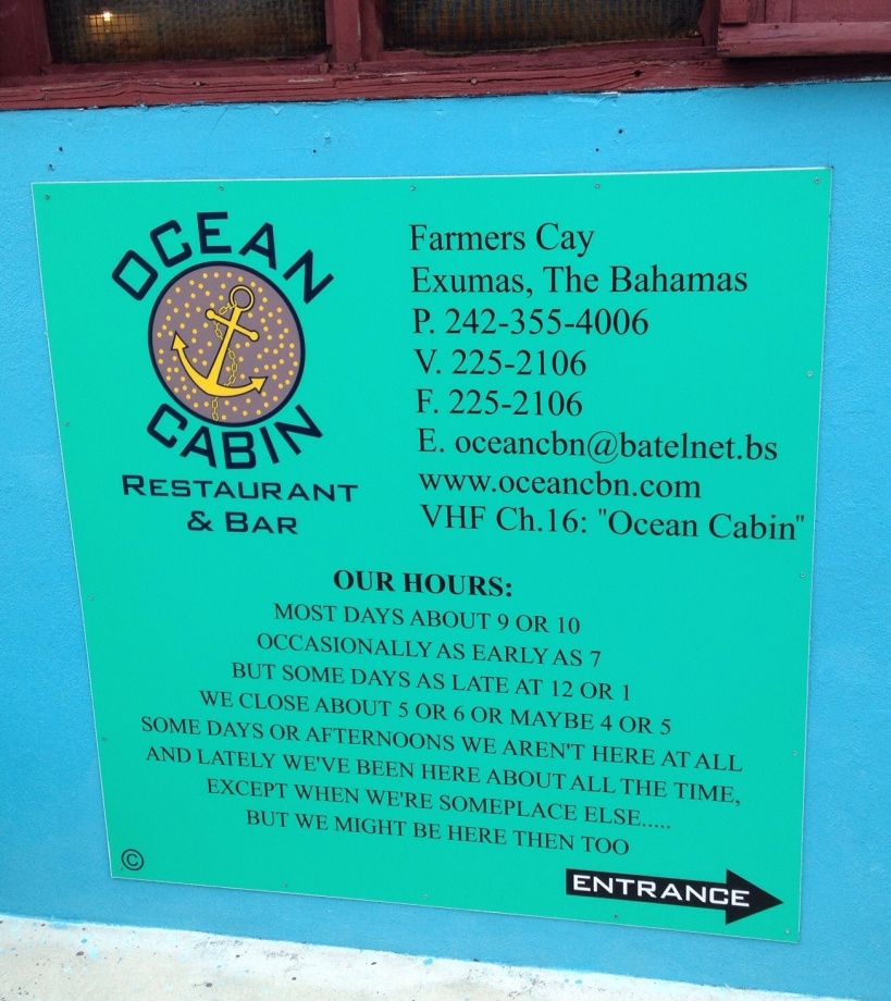 Sign listing the hours at Ocean Cabin