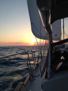 Underway to the US and watching the sunset over choppy waters.