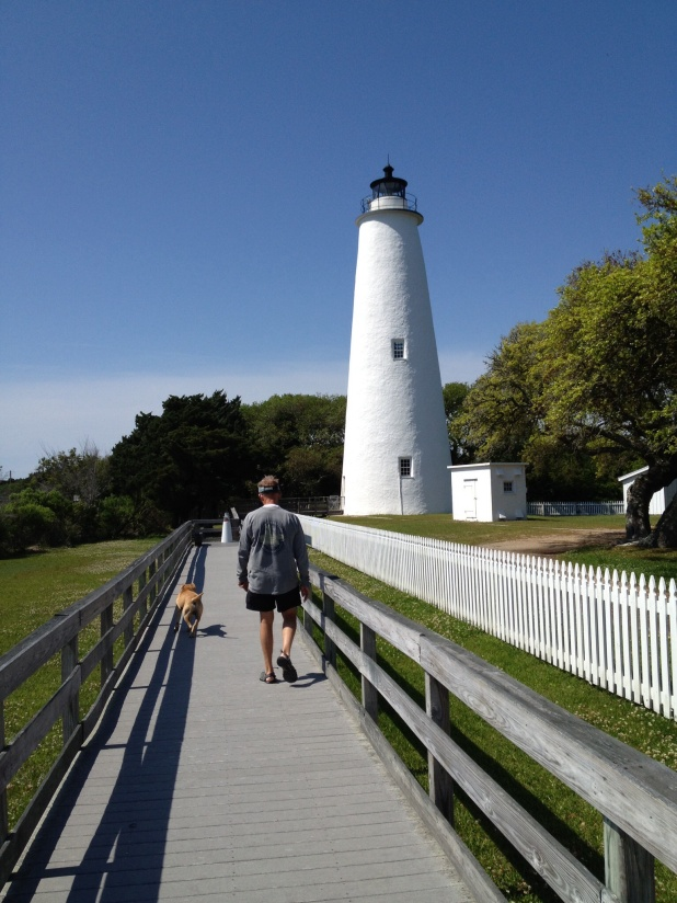 Ocracoke lighthouse. It isn't open to go inside, but the grounds are pretty. Frank meets a new canine friend who escorts him.