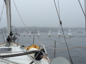 The youth sailing class being towed back to land in the rain in Port Washington